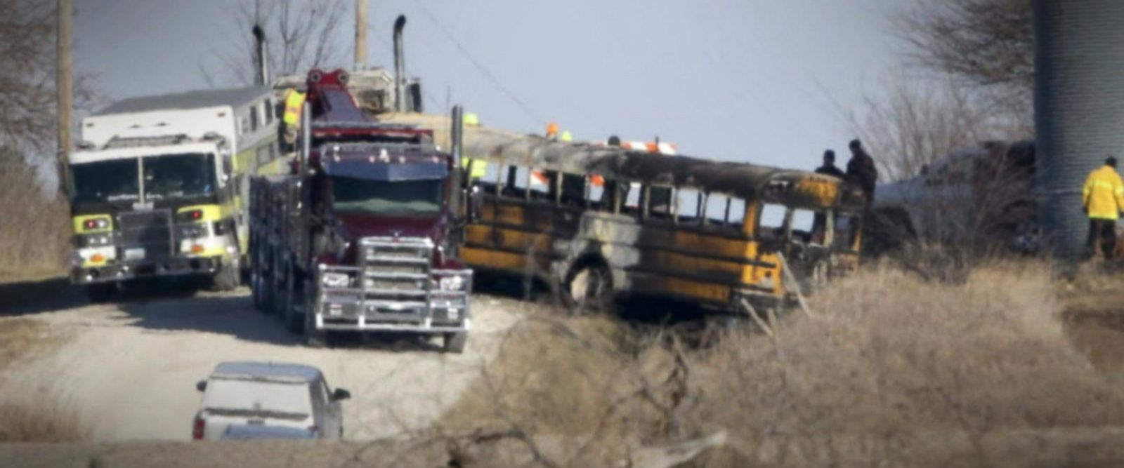 VIDEO: The incident occurred Tuesday morning in the farm town of Oakland as the bus backed out of a driveway and landed in a ditch where it caught fire, Pottawattamie County officials said.