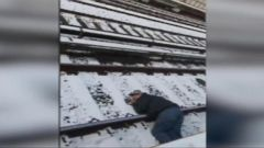 'VIDEO: A man was lying unconscious on the tracks as a train approached a subway station in Brooklyn.' from the web at 'http://a.abcnews.com/images/US/171215_atm_subway_accident_16x9_240.jpg'