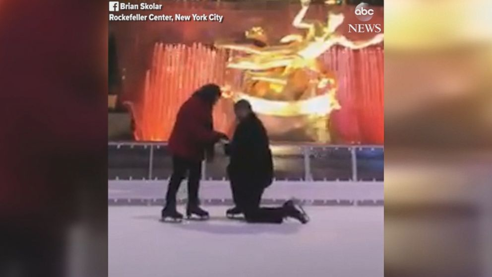 'Brian Skolar got down on one knee to propose1_b@b_1the skating rink.' from the web at 'http://a.abcnews.com/images/US/171229_social_rock_center_proposal_MIX_16x9_992.jpg'