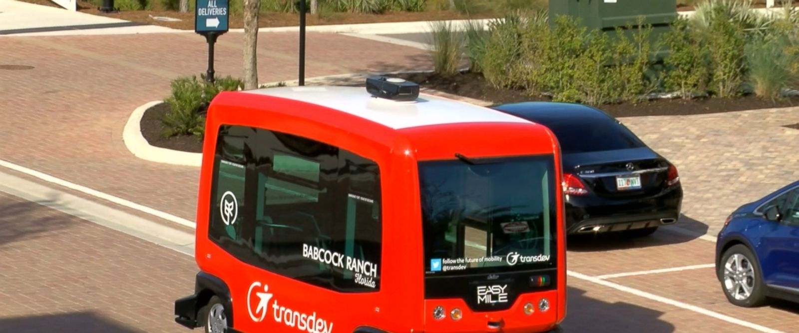 A solar field provides power for the town, including its driverless shuttles.