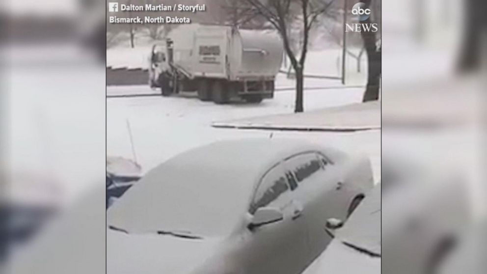 Garbage truck goes slipping and sliding