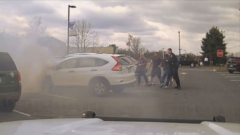 Video shows good Samaritans help police rescue driver from fiery crash