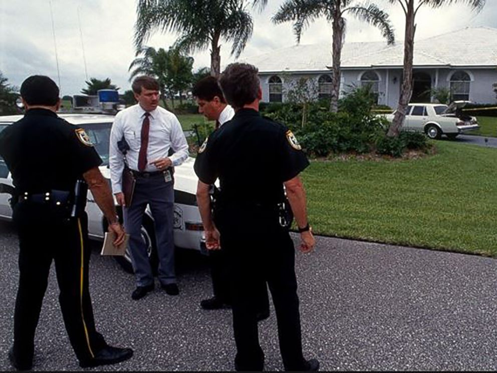 PHOTO: Police stand outside of Marlene Warrens house after her murder in this undated photo.
