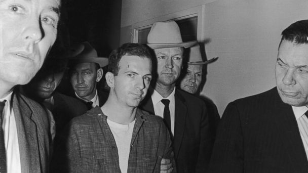 PHOTO: Lee Harvey Oswald is taken into custody by police after allegedly shooting President John F Kennedy, Dallas, Texas, Nov. 22, 1963.