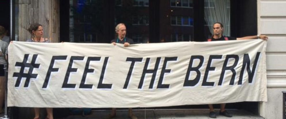 PHOTO: Supporters hold a #feelthebern sign outside the Bernie Sanders NYC event on July 29, 2015.