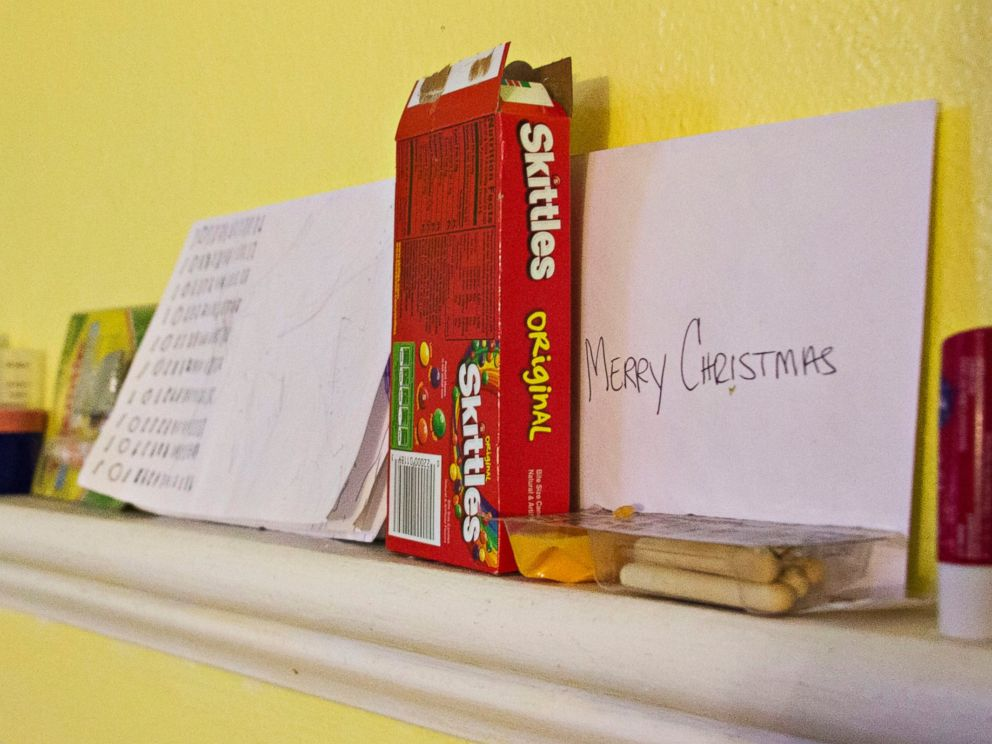PHOTO: A box of Skittles and other possessions belonging to Javier Fores Garcia and his son.