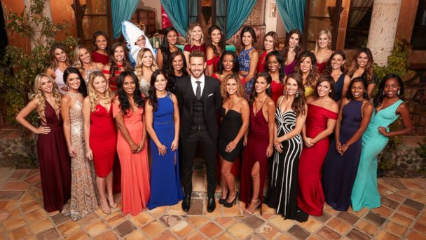 PHOTO: Nick Viall with the women of ABC's
