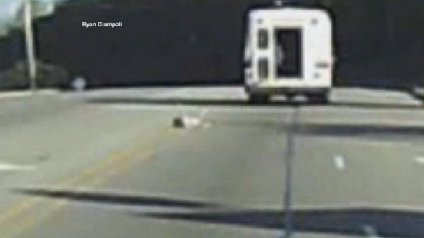 PHOTO: Dramatic video captures a child falling out of a bus on the highway.