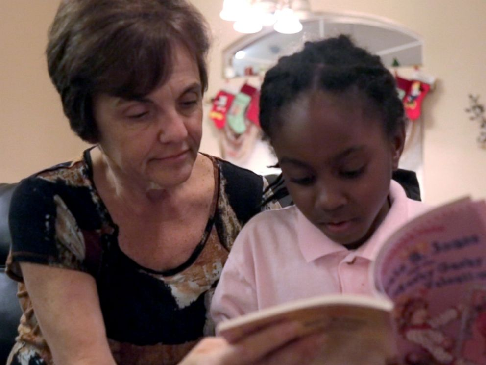 PHOTO: Janet Sylvester reads to one of her five foster children.
