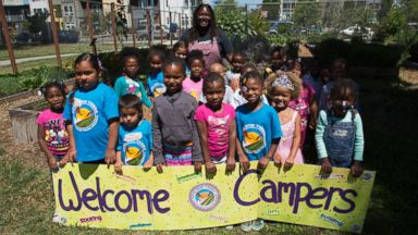 PHOTO: Kelly Carlisle with a young group of Acta Non Verba campers.