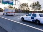 An ambulance carries a patient to the hospital from Newark Liberty International Airport in New Jersey, Oct. 21, 2014.