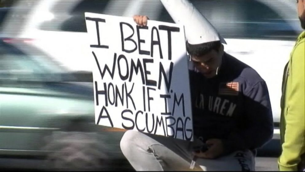 "PHOTO: A Tampa, Fla. woman chooses to embarrass her alleged attacker by having him hold a sign that says ""I beat women. Honk if Im a scumbag."""