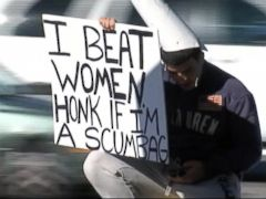 PHOTO: A Tampa, Fla. woman chooses to embarrass her alleged attacker by having him hold a sign that says I beat women. Honk if Im a scumbag.