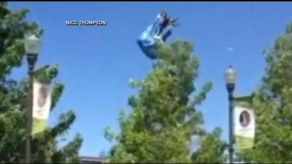 PHOTO: A bounce house went airborne, slamming into lamp posts