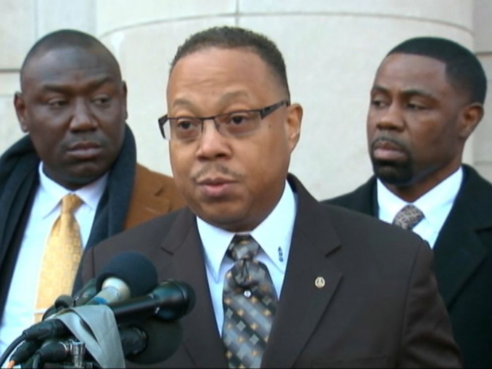 PHOTO: Anthony Gray (center) and Benjamin Crump (left), two of the attorneys for Michael Browns family, spoke in Ferguson, Nov. 13, 2014.