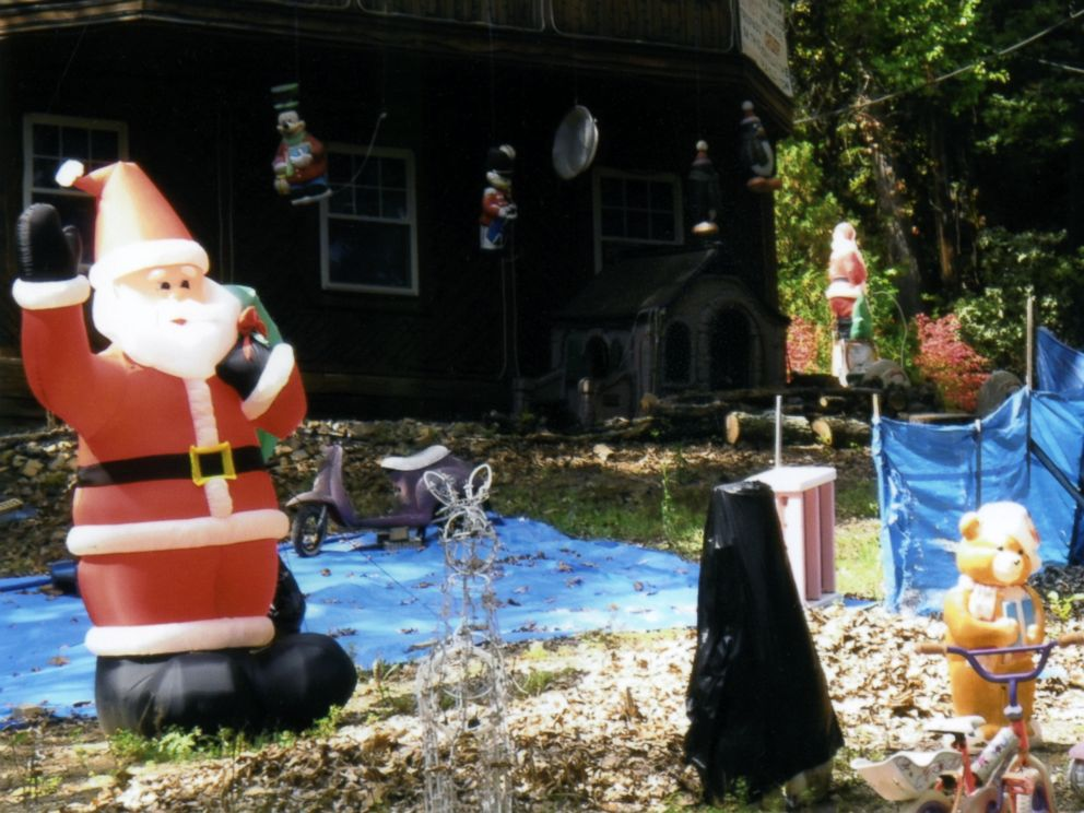 PHOTO: Various decorations, including a hanging Mickey Mouse and a Santa Claus, are pictured here on Bill Ansells yard.