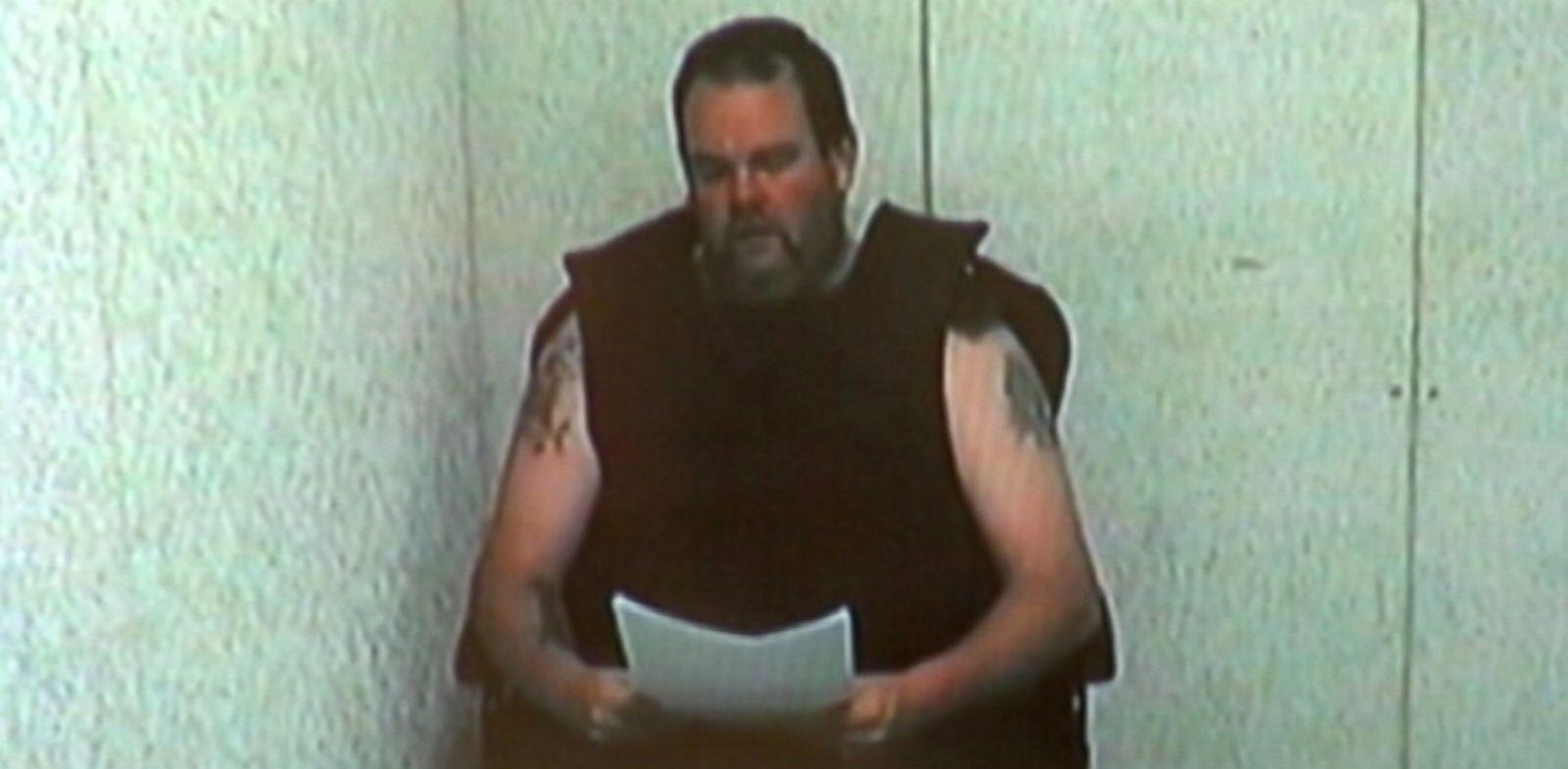 PHOTO: Clinotn Jones reads a statement in court.
