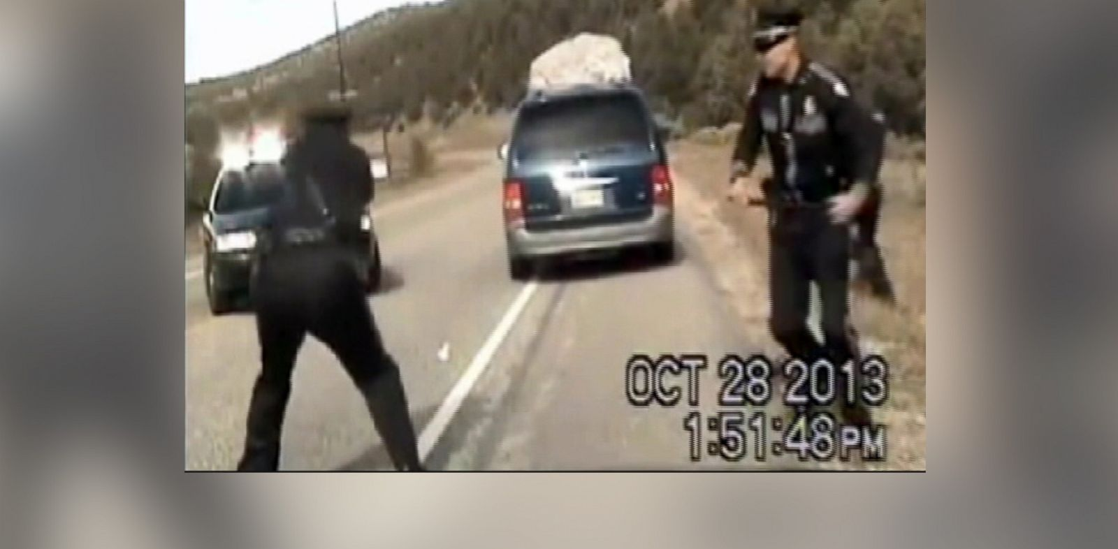 PHOTO: A police cruiser dashboard camera shows Elias Montoya firing shots at a minivan, Oct. 28, 2013.