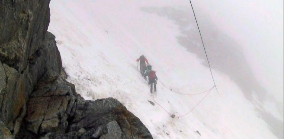 PHOTO: Dad and two kids escape an avalanche on the Mont Blanc mountain in the French Alps.