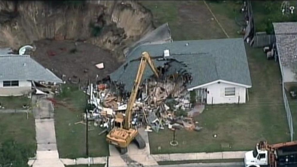 PHOTO: A sinkhole which was 120-feet wide and 30-feet deep opened in Spring Hill, Fla., July 19, 2014.