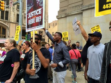 PHOTO: Protesters gather outside the Baltimore City Circuit Court and nearby streets on September 2, 2015 as the pretrial hearing for the six officers charged in the death of detainee Freddie Gray is underway.