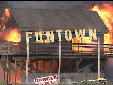 PHOTO: A fire rages at Funtown Pier Amusement Park on the boardwalk in Seaside Heights, N.J., Sept. 12, 2013.