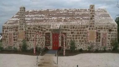 PHOTO: A Guinness World Record has been set in Texas for the biggest gingerbread house. The winner is a 20-foot high house, complete with two chimneys, stained glass windows made of candy and even electricity, all of it edible.