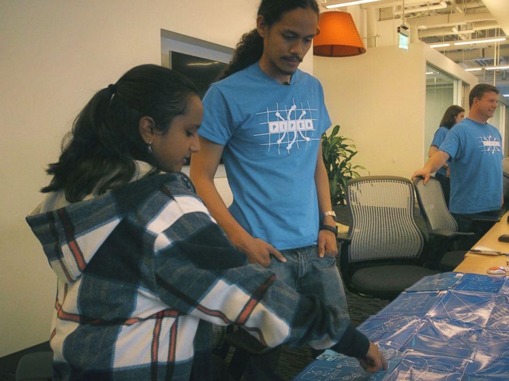 PHOTO: Hari Bhimaraju goes over blueprints at the San Francisco based tech company Piper.