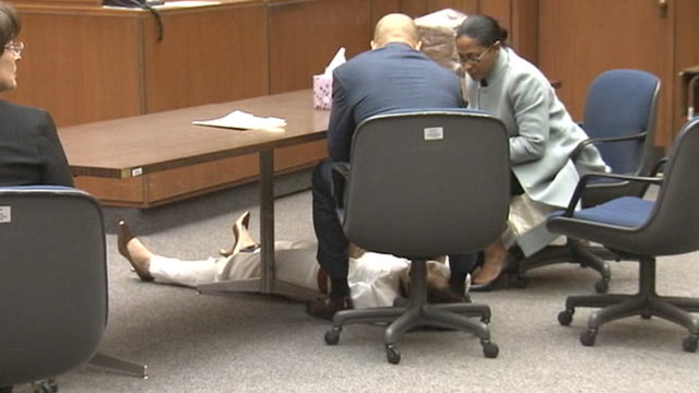 PHOTO:A former California Highway Patrol officer collapsed onto the floor just moments after being found guilty of killing her husband three years ago near a freeway off-ramp.