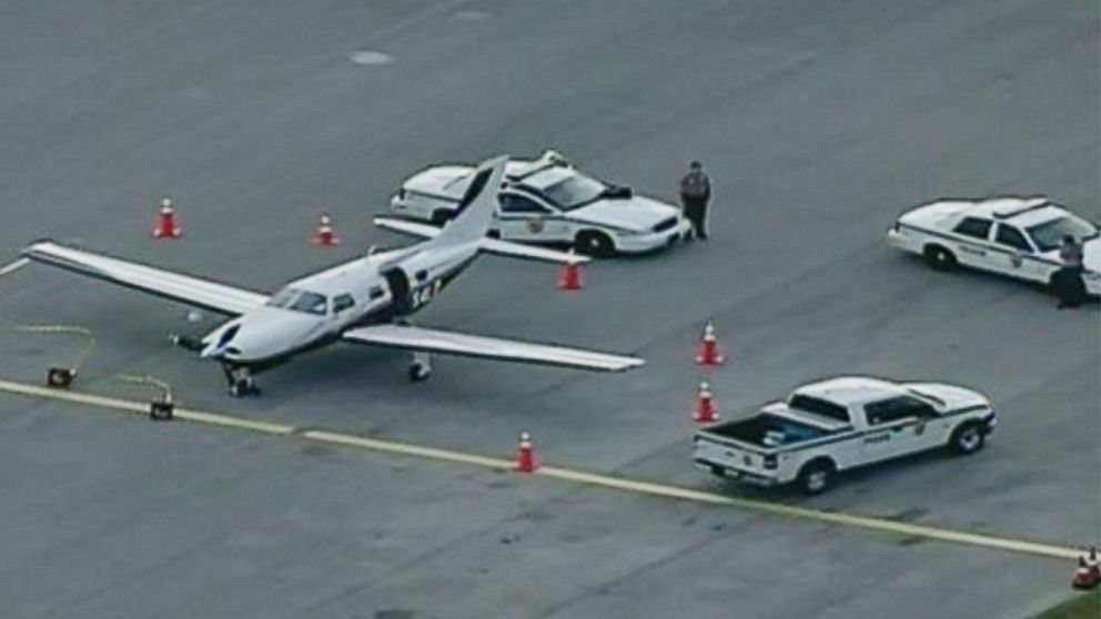 PHOTO: Miami-Dade Police surround a private plane at the Tamiami Airport as part of their investigation into how a man reportedly fell out of the aircraft while in-flight.
