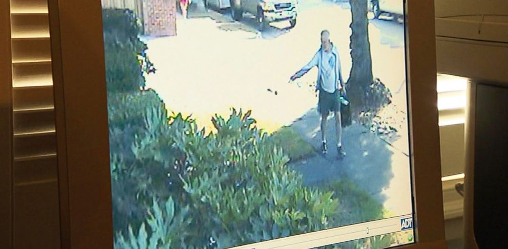 PHOTO: Former San Marino, California, mayor Dennis Kneier is seen on this surveillance video throwing a bag of dog poop onto Philip Laos walkway.