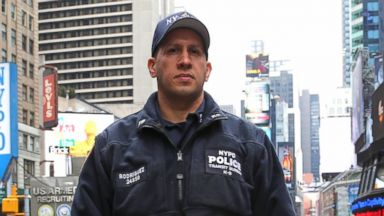 PHOTO: NYPD Transit Crime Unit Officer Juan Rodriguez with Cezar.