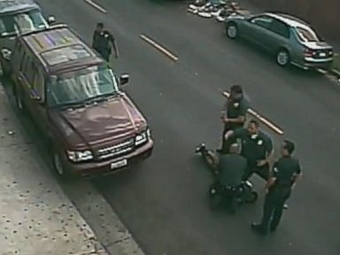 PHOTO: A video shows Los Angeles Police Department officers beating Clinton Alford Jr. on the ground in October, 2014.