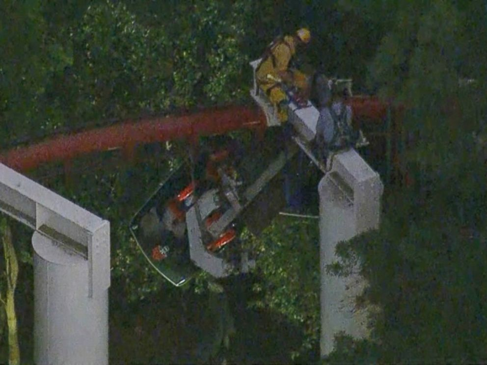 PHOTO: Firefighters and park maintenance workers in harnesses removed the stranded riders one by one.