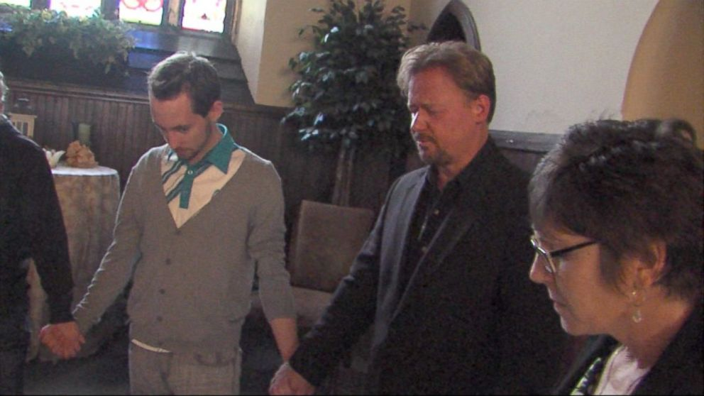 PHOTO: Frank Schaefer, second from right, and his son, Tim, take place in a prayer vigil.