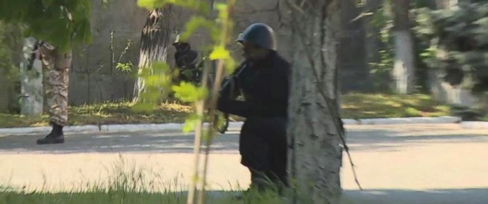 PHOTO: A gunman in Mariupol, Ukraine, where violence erupted seemingly out of nowhere on May 7.