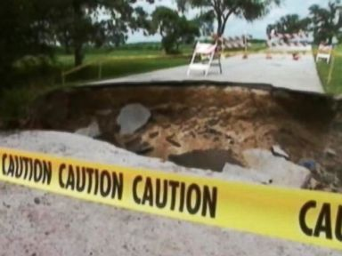 Mother, Son Drive Into Sinkhole, Truck Rides Over Them