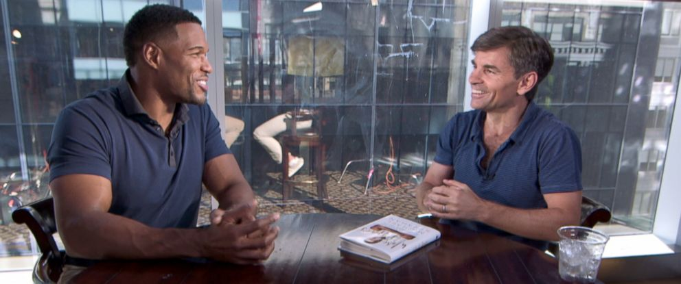 "PHOTO: ""Good Morning America"" special contributor Michael Strahan talks to ""GMA"" co-host George Stephanopoulos about Strahans new memoir """"Wake Up Happy: The Dream Big, Win Big Guide to Transforming Your Life."""