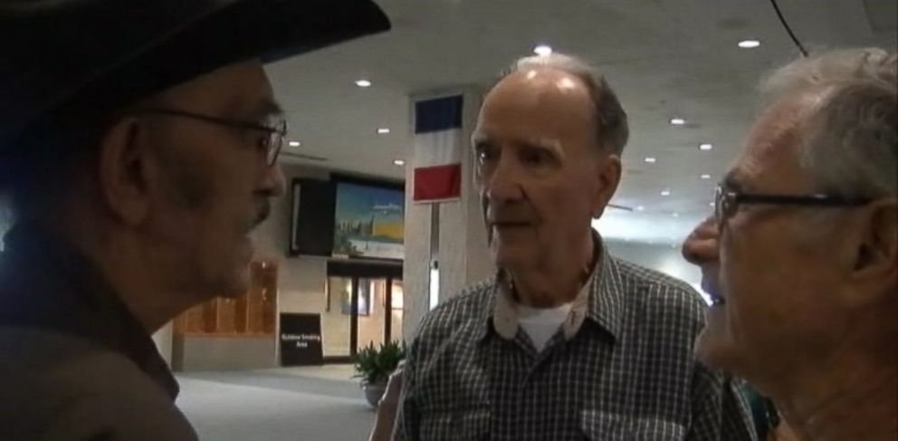 PHOTO: Three brothers separated at birth meet for first time at a Florida airport.