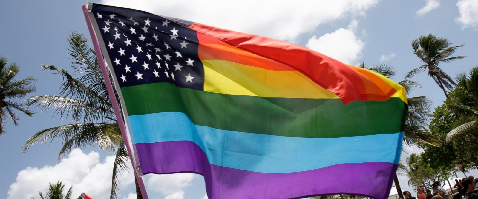 A rainbow American flag is seen here.