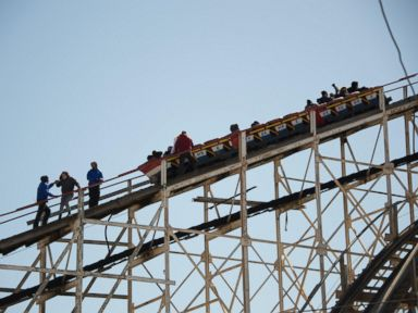 PHOTO: Riders are evacuated from the Cyclone roller coaster in Coney Island, New York City on March 29, 2015.