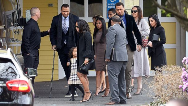 Shayanna Jenkins Hernandez, front, fiancee of former New England Patriots tight end Aaron Hernandez, arrives with their daughter Avielle Janelle Hernandez, and others at O'Brien Funeral Home, April 24, 2017, in Bristol, Conn.