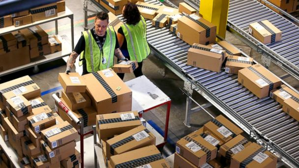 PHOTO: Amazon.com employees organize outbound packages at an Amazon.com Fulfillment Center on