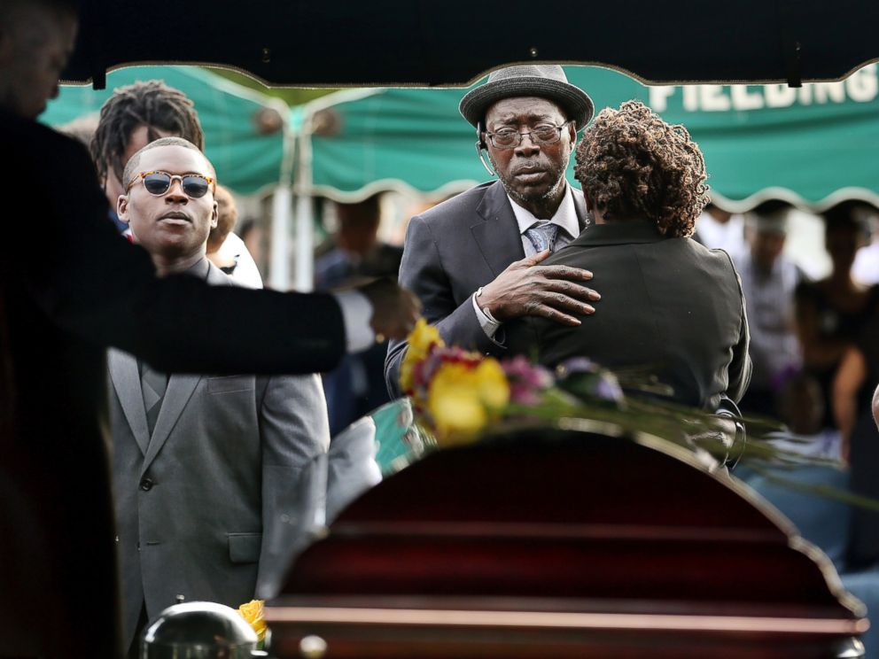 PHOTO: Parents of Tywanza Sanders, Tyrone Sanders and Felicia Sanders comfort each other at the graveside of their son at Emanuel AME Cemetery in Charleston, South Carolina, in this June 27, 2015 file photo.