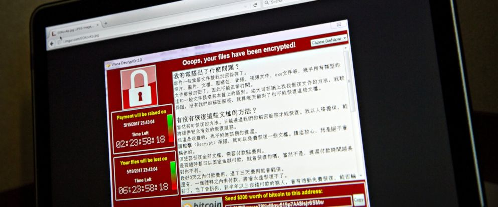PHOTO: A screenshot of the warning screen from a purported ransomware attack seen on a laptop in Beijing, May 13, 2017.