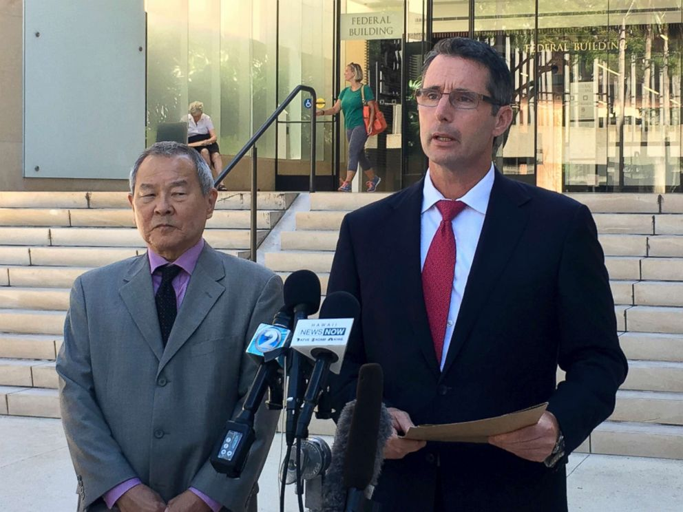PHOTO: Paul Delacourt, the FBI special agent in charge of the Hawaii bureau, right, speaks at a news conference as Acting United States Attorney Elliot Enoki, left, listens outside federal court in Honolulu, July 10, 2017.