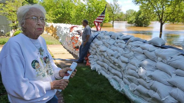 PHOTO: Barb Neels, 78, looks at the rising waters of the Meramec River, May 2, 2017, in Fenton, Mo. Neels has lived on Riverside Drive for 55 years and says she has only seen flooding like this once, in the flood in 2015.