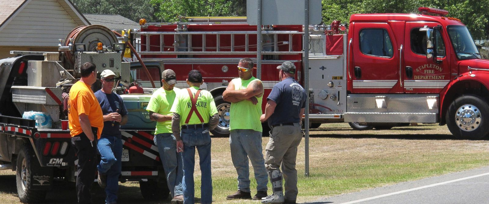 PHOTO: Firefighters take a break on May 8, 2017, outside a church in St. George, Ga., where officials have issued a mandatory evacuation as a vast wildfire burns at the towns edge.
