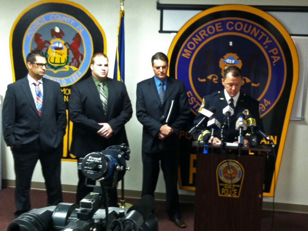 PHOTO: Pocono Mountain Regional Police Chief Christopher Wagner, with fellow law enforcement officers, as he speaks during a Sept. 15, 2015, news conference about plans to arrest 37 people in the December 2013 death of 19-year-old Chun Michael Deng.