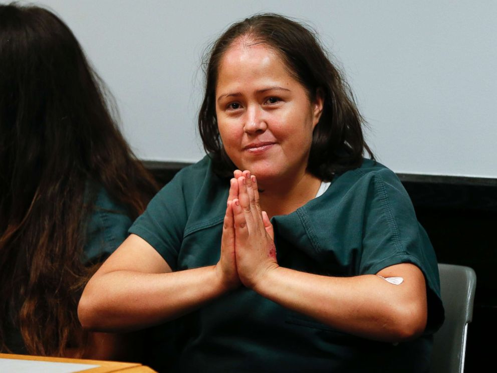 PHOTO: Isabel Martinez gestures towards news cameras during her first court appearance, July 7, 2017, in Lawrenceville , Ga. Martinez is charged with killing four of her children and their father.